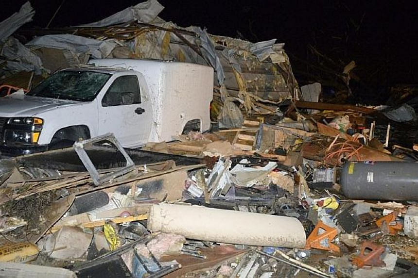 A damaged vehicle is seen amid debris after a tornado hit the town of Mayflower, Arkansas around 7:30 pm CST, late on April 27, 2014. -- PHOTO: REUTERS