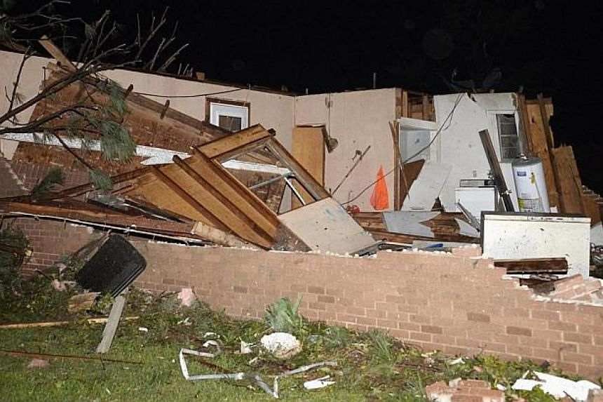 A damaged home is seen after a tornado hit the town of Mayflower, Arkansas around 7:30 pm CST, late on April 27, 2014. -- PHOTO: REUTERS