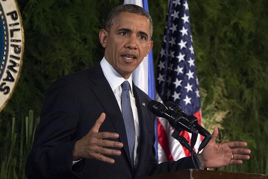 US President Barack Obama speaks during a bilateral press conference with the Philippines President Benigo Aquino (not in picture) at Malacanang Palace in Manila on April 28, 2014.United States President Barack Obama said the US would unveil ne