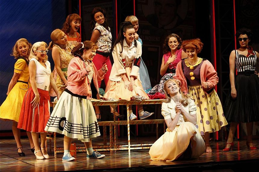 Australian actress Gretel Scarlett (foreground) plays the lead role in the Grease musical. -- PHOTO: JEFF BUSBY