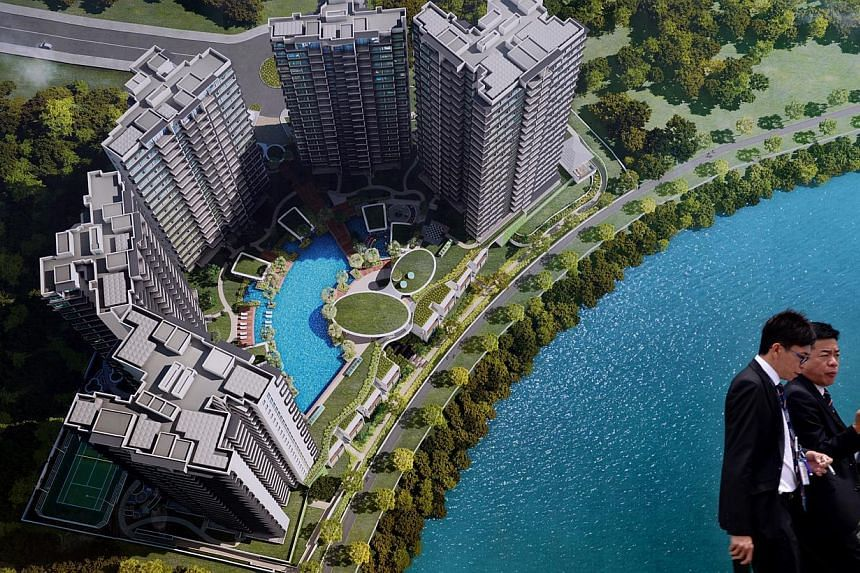 A poster depicting the RiverTrees Residences condominium in Fernvale in Sengkang. Two-bedders, which range from 570 sq ft to 710 sq ft, sold the best when the project was launched in February. -- ST FILE PHOTO