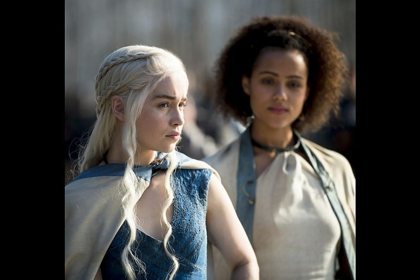 HBO's Game Of Thrones, with (from left) actresses Emilia Clarke and Nathalie Emmanuel, is reportedly the world's most pirated TV show with more than four million illegal downloads per episode. -- PHOTO: HBO ASIA