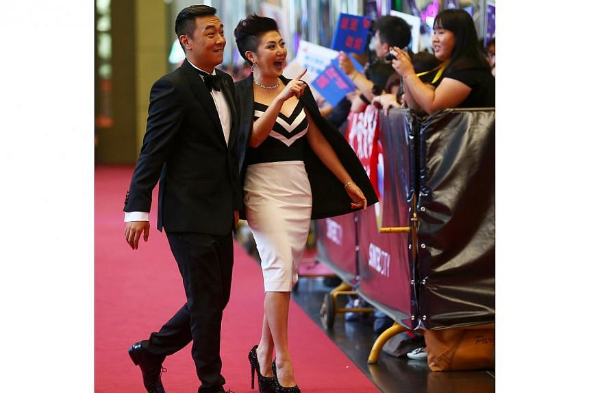 Hosts Guo Liang (right) and Quan Yifeng as they walk down the red carpet together. -- TNP PHOTO: GAVIN FOO