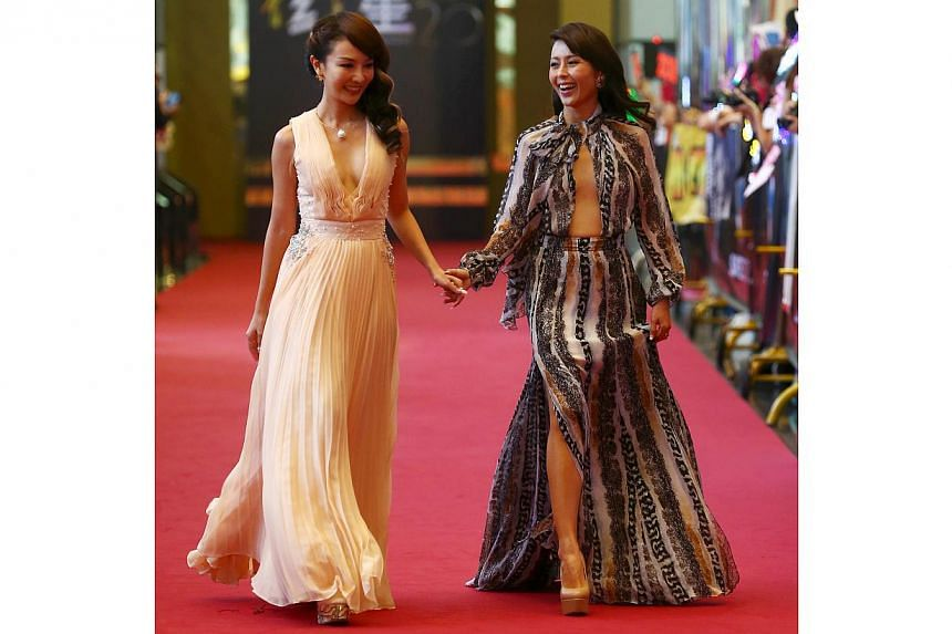 Chris Tong (left) and Priscelia Chan walked down the red carpet. -- TNP PHOTO: GAVIN FOO