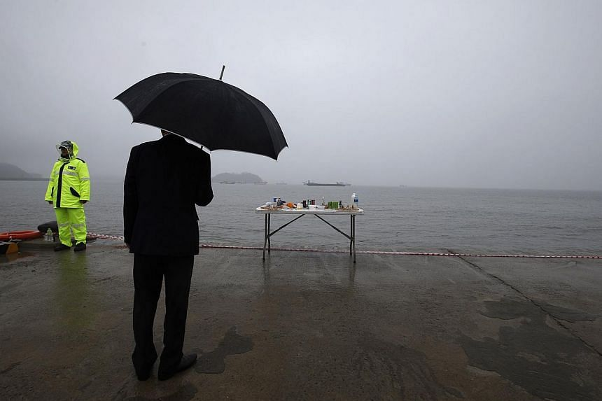 An altar dedicated to the missing and dead passengers on board the capsized Sewol ferry, at a port where family members are waiting for news from the search and rescue team in Jindo on April 28, 2014. -- PHOTO: REUTERS