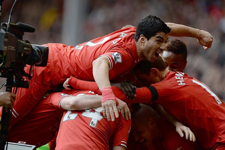 Liverpool striker Luis Suarez (top) won England's Professional Footballers' Association's Player of the Year award on Sunday, on April 27, 2014. -- PHOTO: REUTERS