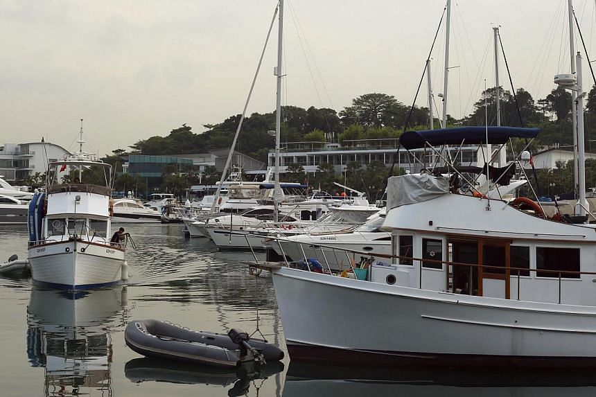 Private yachts are moored in the waters of ONE15 Marina Club on Sentosa island in Singapore on April 22, 2014. -- FILE PHOTO: REUTERS
