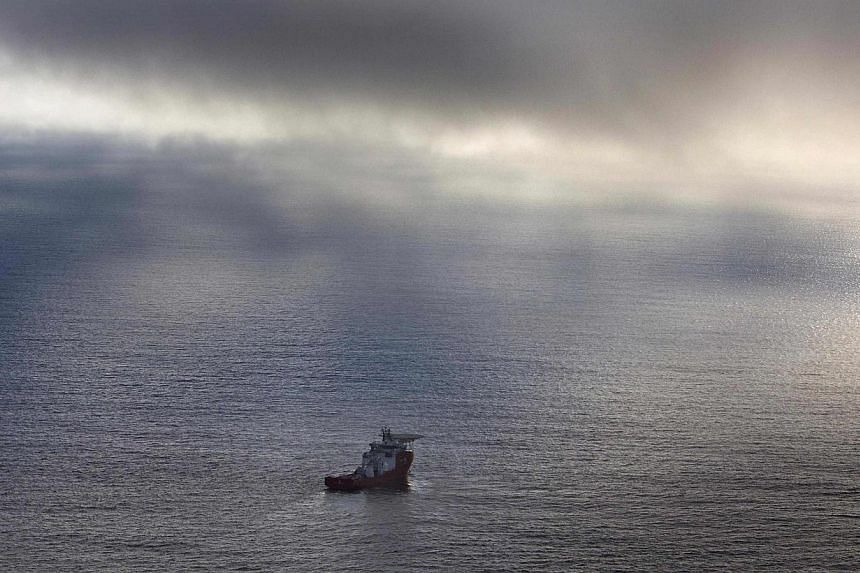 The Australian Defence Vessel Ocean Shield sails in the southern Indian Ocean as it continues to search for the missing Malaysia Airlines Flight MH370 in this picture released by the Australian Defence Force April 15, 2014. -- FILE PHOTO: REUTERS
