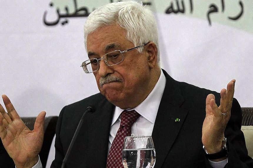 Palestinian Authority President Mahmud Abbas gestures as he gives a speech during a meeting with the Palestine Liberation Organisation (PLO)'s Central Council in the West Bank city of Ramallah on April 26, 2014. -- FILE PHOTO: AFP