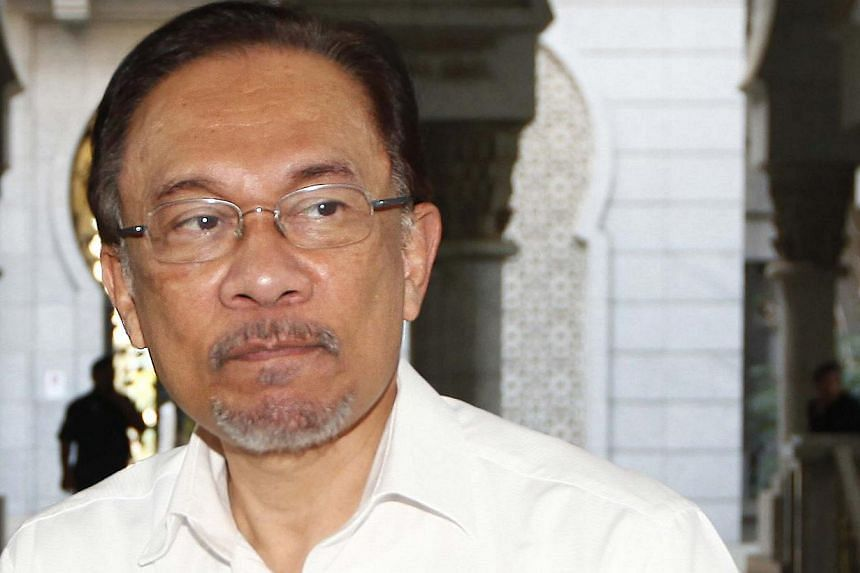 Malaysian opposition leader Anwar Ibrahim arrives at a court house in Putrajaya, on March 7, 2014. US National Security Adviser Susan Rice on Monday, April 28, 2014, met Malaysian opposition leader Anwar Ibrahim and expressed concern at a sodomy conv