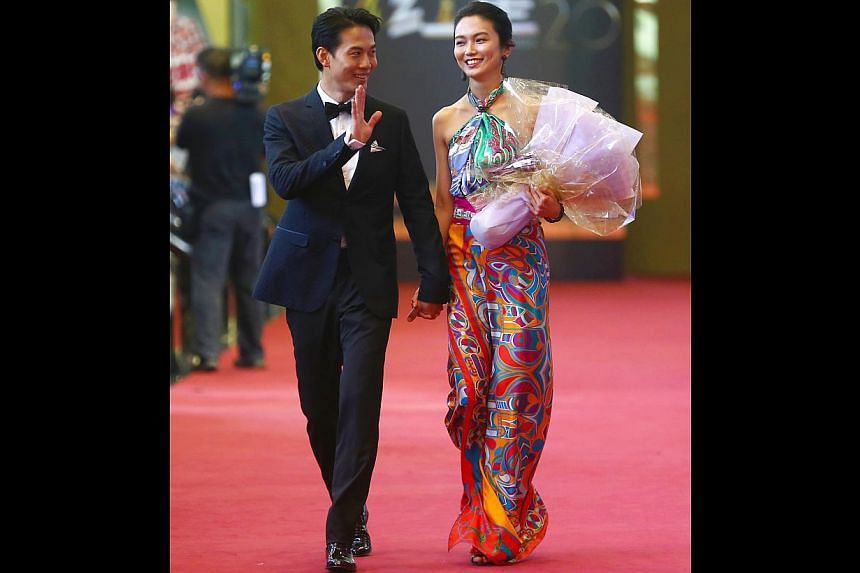 """Joanne Peh (right) and Qi Yu Wu gets an A plus for creativity. Her """"dress"""" was actually four Hermes scarves tied together. The bold colours complemented her sunshine personality.-- TNP PHOTO: GAVIN FOO"""