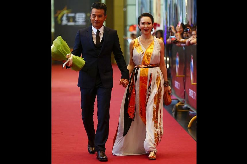 Fann Wong's (right, with Christopher Lee) baby bump was the star of the night and that was in part due to this Bottega Veneta grecian-style gown that draped over her belly ever so gently. The gold panels on her dress added to her glow.-- TNP PH