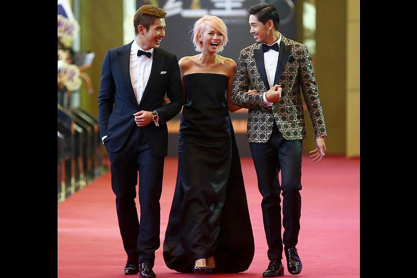 Felicia Chin's (centre, with Elvin Ng and Romeo Tan) pink crop looked super fun, but her Dsquared2 gown was so drab. It was far too baggy for the petite actress.-- TNP PHOTO: GAVIN FOO