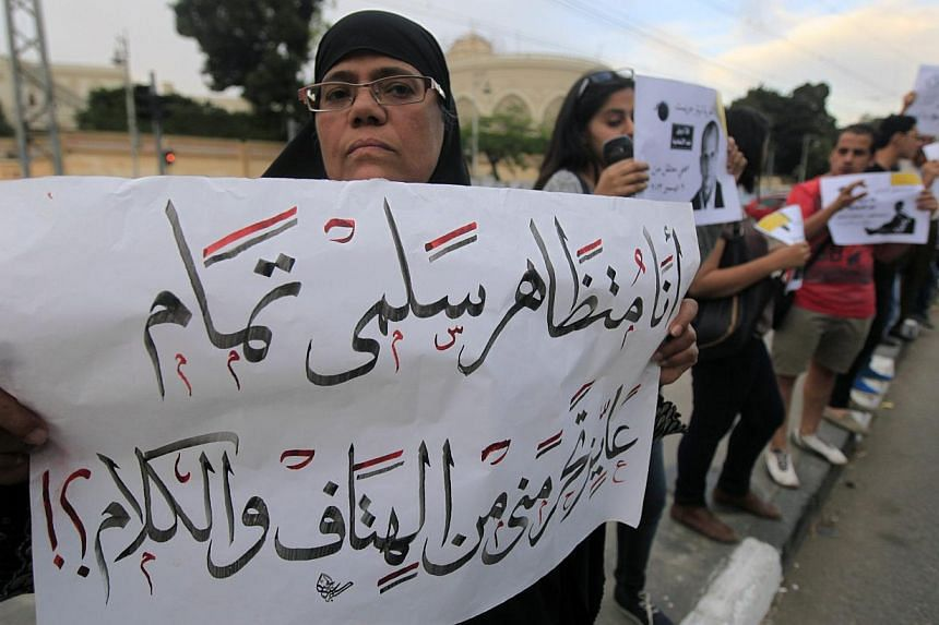 Members of the April 6 movement and liberal activists form a human chain against a law restricting demonstrations as well as the crackdown on activists and calling for the release of activists in detention in front of El-Thadiya Egyptian Presidential