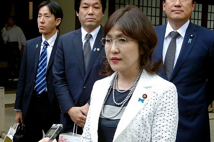 Japanese State Minister in charge of administrative reform Tomomi Inada speaks to reporters after she visited the controversial Yasukuni shrine to honour the war dead in Tokyo, on April 28, 2014. A Japanese cabinet minister known for her outspoken na