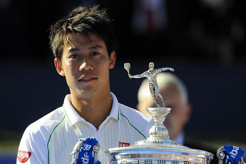 Japanese tennis player Kei Nishikori poses after beating Columbia's Santiago Giraldo during the ATP Final Barcelona Open Conde De Godo tennis tournament in Barcelona, on April 27, 2014. Nishikori claimed his fifth career title as he became the first