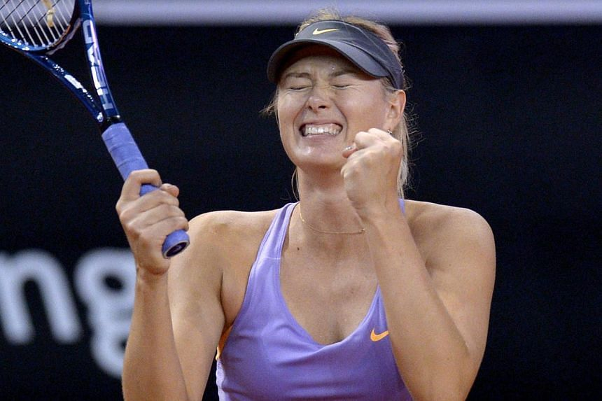 Russia's Maria Sharapova celebrates after defeating Serbia's Ana Ivanovic in the final match of the WTA Porsche Tennis Grand Prix in Stuttgart, southwestern Germany, on April 27, 2014. Sharapova claimed a hat-trick of Stuttgart titles on Sunday after