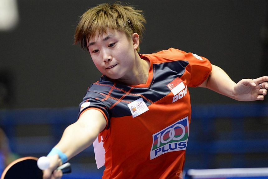 Feng Tianwei of Singapore returns a shot against Sarah De Nutte of Luxembourg at the 2014 World Team Table Tennis Championships in Tokyo, on April 28, 2014. Singapore's women paddlers beat unheralded Luxembourg 3-0 to begin their campaign at the Worl