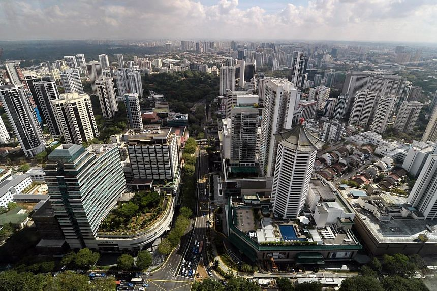 Every rooftop on the Singapore map will be coloured red, orange or yellow, depending on how suited it is to harnessing solar energy. -- FILE PHOTO: AFP