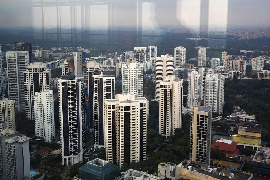 Resale prices for private homes fell in all regions in March as the property market continued to slow down, with the central region being the worst hit. -- FILE PHOTO: REUTERS