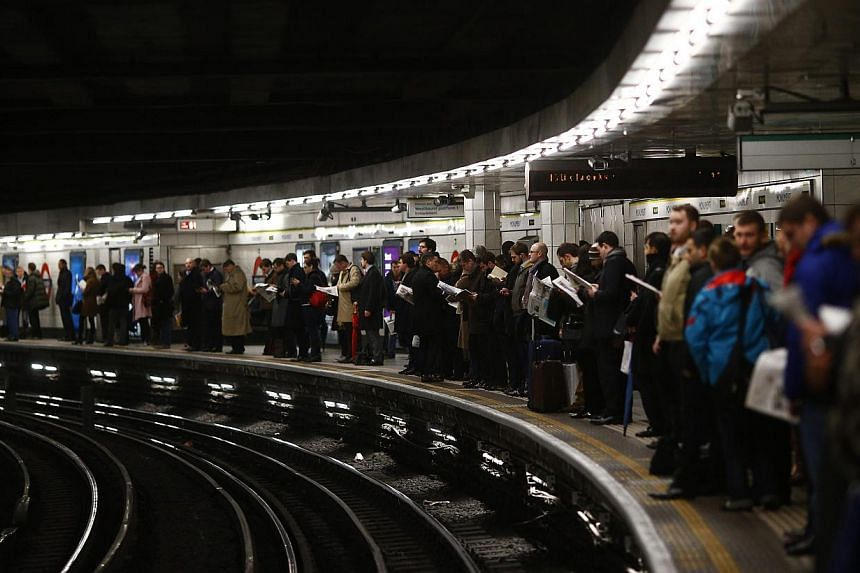 Commuters wait during the evening rush hour on the second day of a strike by London Underground workers in central London, on Feb 6, 2014. -- FILE PHOTO: REUTERS