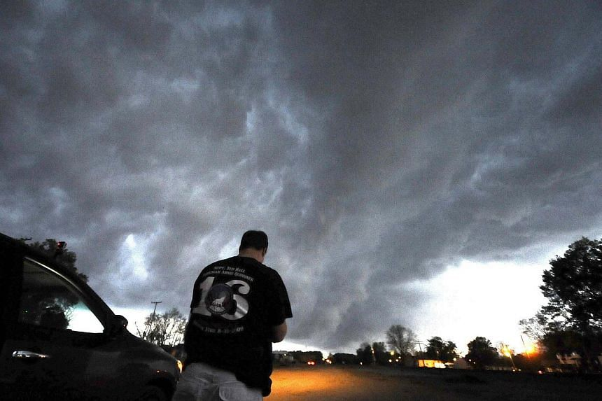 Low level thunder storms supercells pass over the area of Bearden, Arkansas on April 24, 2014.-- FILE PHOTO: REUTERS