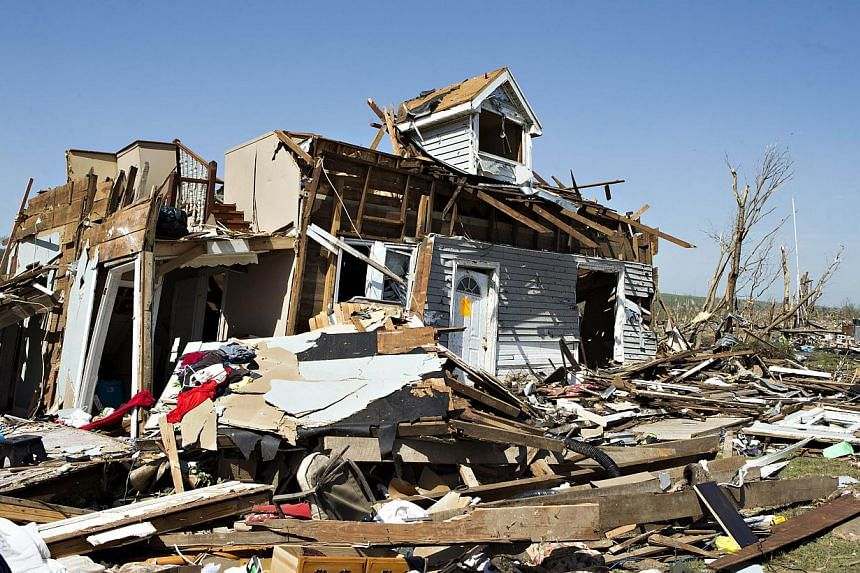 A home lies in ruins after a tornado yesterday tore through the area for the second time in three years, on April 28, 2014 in Vilonia, Arkansas. -- PHOTO: AFP