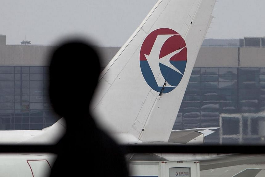 A China Eastern Airlines Corp. airplane is parked on the tarmac at Hongqiao International Airport in Shanghai, China, on Saturday on May 12, 2012.-- FILE PHOTO:BLOOMBERG