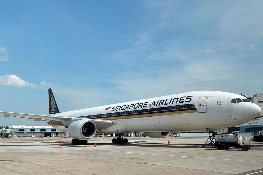 A Singapore Airlines (SIA) aircraft at the Changi Airport. Singaporeans view planes as a safe option to travel, although cars are seen as the safest, according to a recent street poll conducted by The Straits Times Digital team. -- ST FILE PHOTO