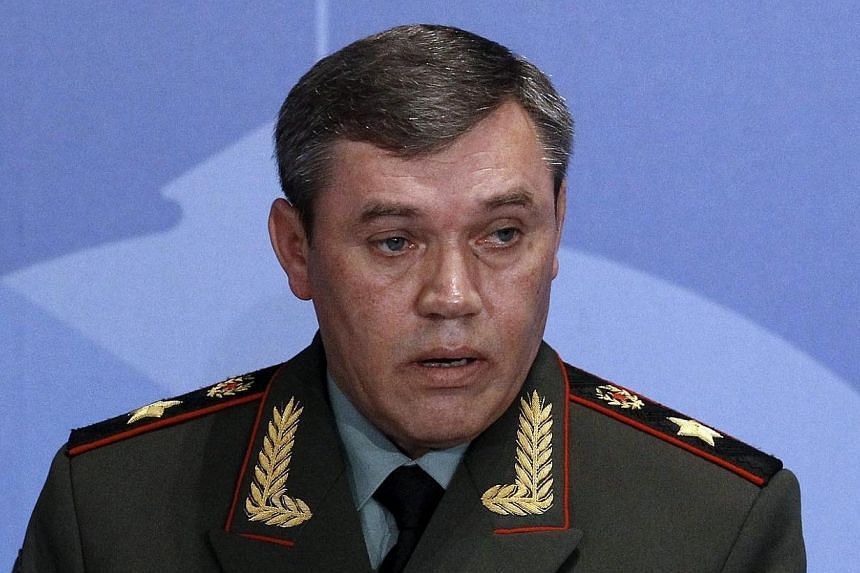 Russian armed forces Chief-of-Staff Valery Gerasimov delivers a speech during a conference titled Military and Political Aspects of European Security in Moscow on May 23, 2013.The European Union imposed asset freezes and travel bans on 15 Russi