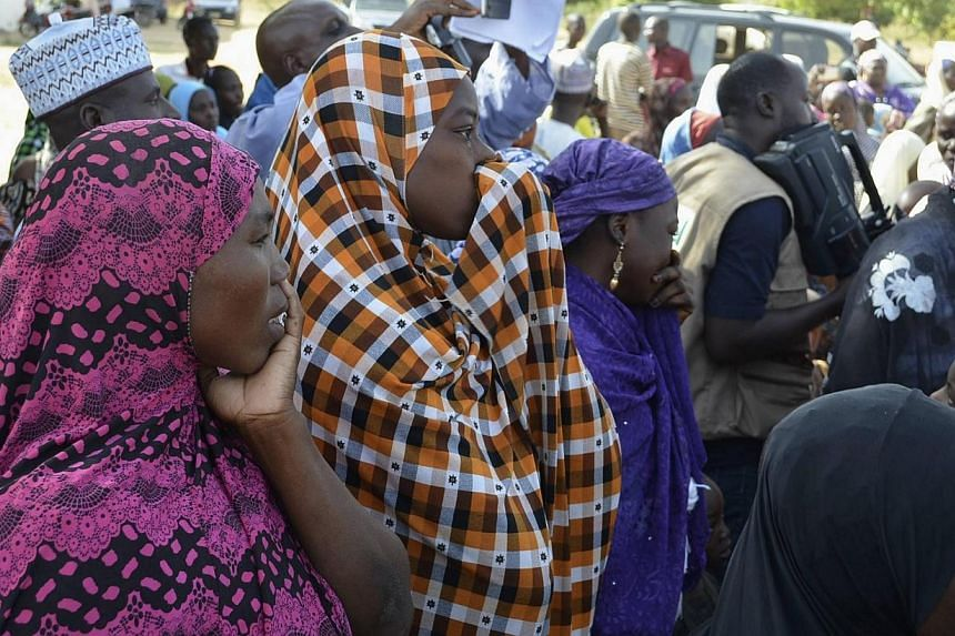 Mothers of kidnapped school girls react during a meeting with the Borno State governor in Chibok, Maiduguri, Borno State on April 22, 2014.Nigerian parents lashed out on Tuesday, April 29, 2014, at the government's failure to rescue scores of s
