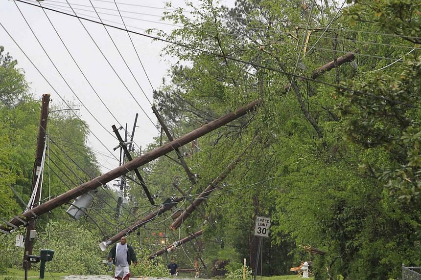 A resident makes his way down Jackson Street and away from the tornado-damaged area in Tupelo, Mississippi on April 28, 2014. -- PHOTO: REUTERS