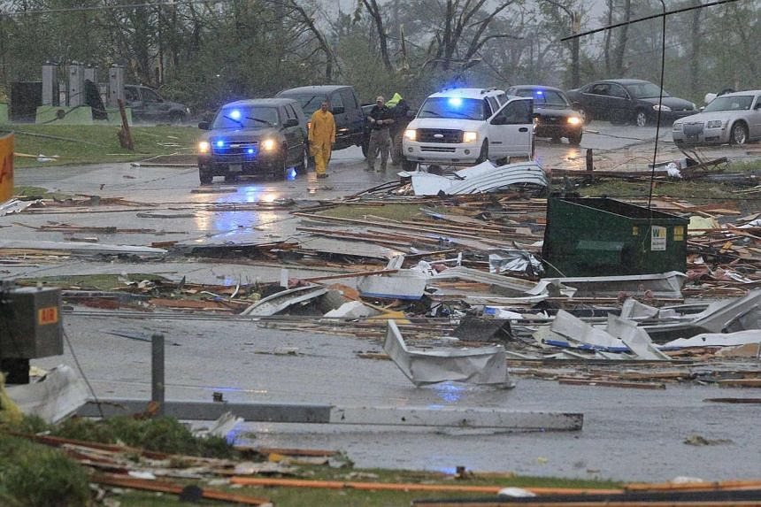 First responders begin to secure areas minutes after a tornado tore through Tupelo, Mississippi on April 28, 2014, on the second day of ferocious storms that have claimed at least 19 lives in the southern United States. -- PHOTO: REUTERS