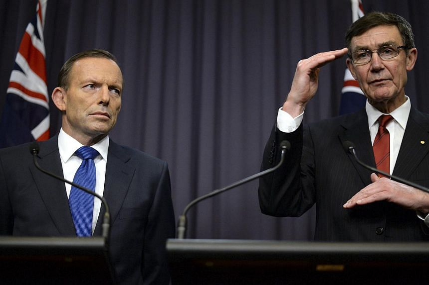 Mr Tony Abbott (left) and search coordinator Angus Houston speaking to the media at Parliament House yesterday.