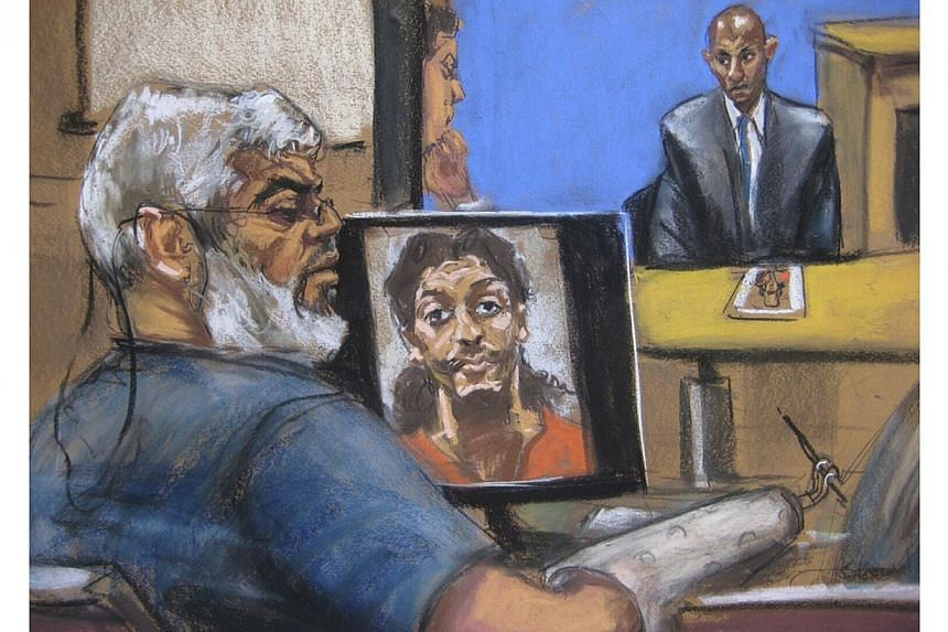 Abu Hamza al-Masri, the radical Islamist cleric facing US terrorism charges, sits while a picture of shoe bomber Richard Reid is seen on a computer screen (left) and Saajid Badat is questioned via teleconference in Manhattan federal court in New York