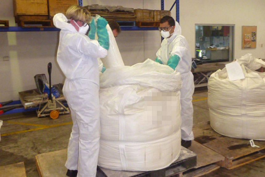 This file handout photo received on Feb 28, 2013, shows Australian Federal Police officers with some of their largest ever seizure of methamphetamine, with an estimated street value of around US$446 million. -- FILE PHOTO: AFP