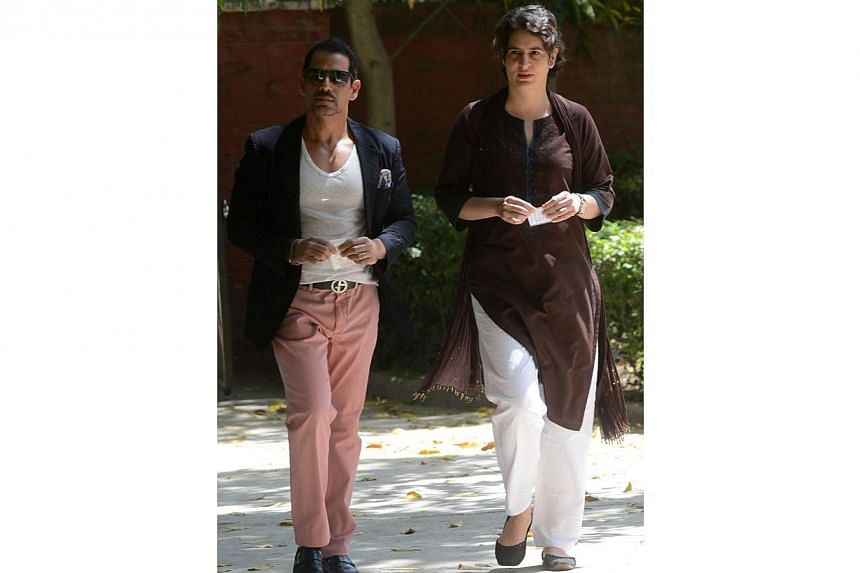 Priyanka Gandhi (right), daughter of India's Congress Party president Sonia Gandhi, and her husband Robert Vadra arrive at a polling station to cast their votes in New Delhi on April 10, 2014. -- FILE PHOTO: AFP