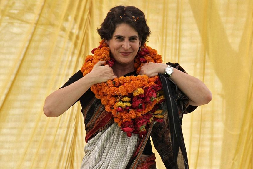 Priyanka Gandhi Vadra, daughter of India's ruling Congress Party chief Sonia Gandhi, adjusts her flower garlands as she campaigns for her mother during an election meeting at Rae Bareli in the northern Indian state of Uttar Pradesh on April 22, 2014.