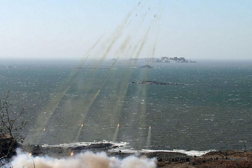This undated file photo released by North Korea's official Korean Central News Agency (KCNA) via the Korean News Service (KNS) on March 14, 2013 shows a live shell firing drill being conducted by North Korea at an unconfirmed location. North Korea he