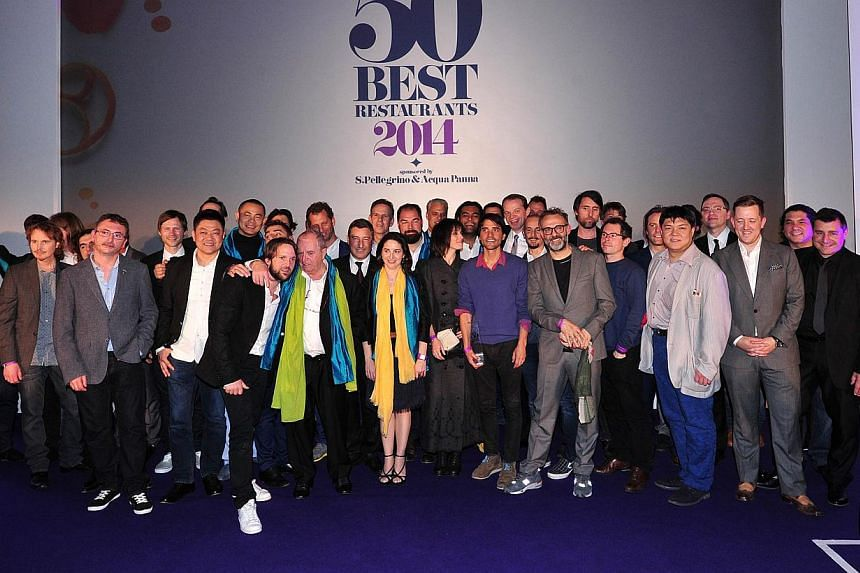 Head chefs from the world's top 50 restaurants pose for a picture at the World's 50 Best Restaurants Awards 2014, at the Guildhall in central London, on April 28, 2014. -- PHOTO: AFP