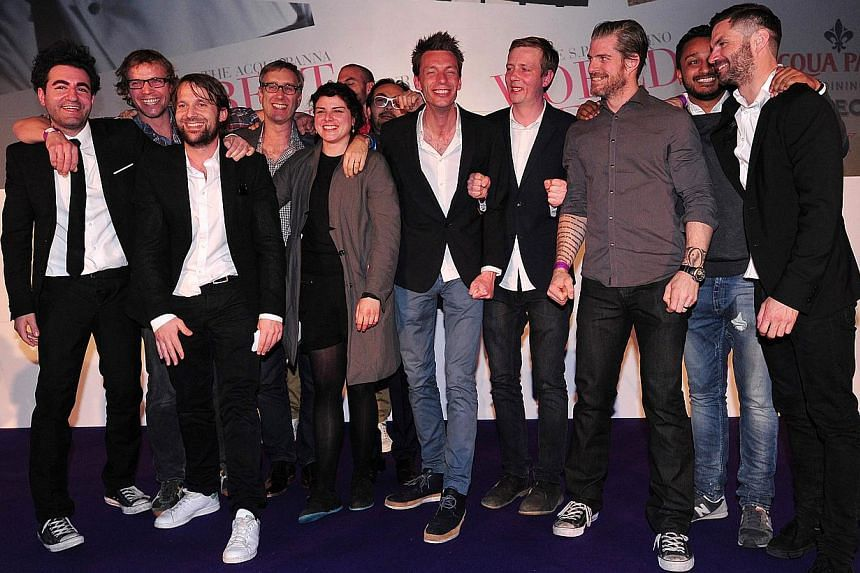 Staff from Danish restaurant Noma, including head chef Rene Redzepi (third from left) pose for pictures after winning first place at the World's 50 Best Restaurants Awards 2014, at the Guildhall in central London, on April 28, 2014. -- PHOTO: AFP