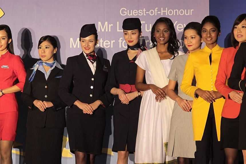 Cabin crew uniforms from 26 different airlines operating at Changi Airport displayed in a fashion show at the Changi Airline Awards held at Pan Pacific Hotel, on April 29, 2014. -- ST PHOTO: NEO XIAOBIN