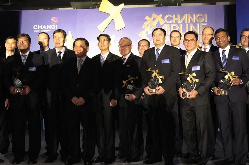 China Eastern Airlines vice-president Mr Tian Liuwen (fourth from right) seen on stage with other winners after receiving the Partner of the Year award on behalf of China Eastern Airlines from Minister for Transport Lui Tuck Yew during the Changi Air