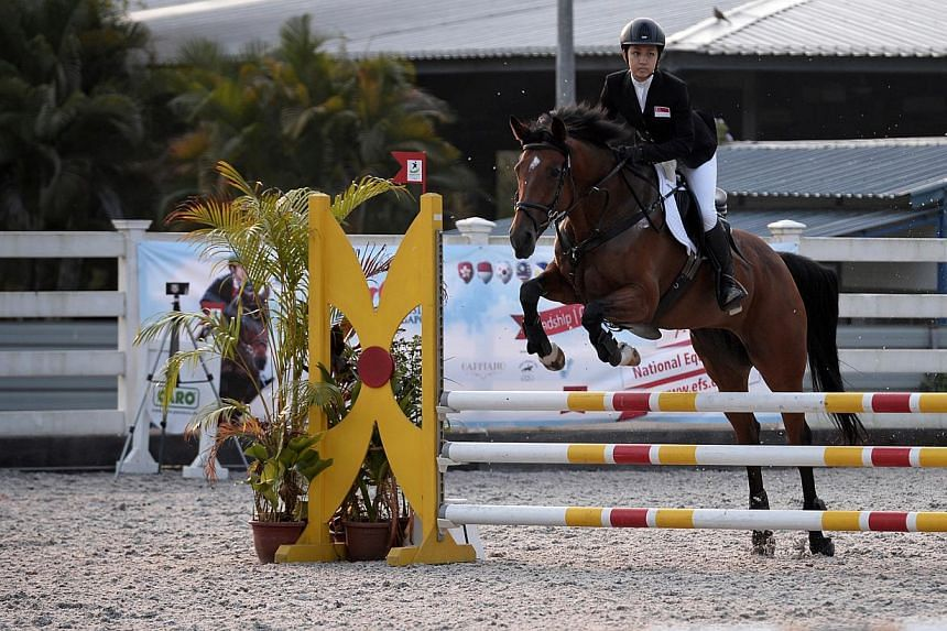 Singapore's Janine Khoo, riding Roxy Girl, during the first round of the Concours de Saut International (young riders) (CSIY-B) team event held at the National Equestrian Centre, on March 8, 2014. The six newly endorsed sports are rowing, equestrian,