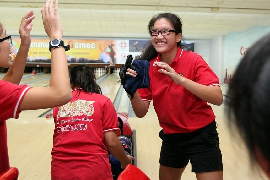 Rae-Marie Lee of ACJC celebrates with teammates after the last game of the Schools National A Division Bowling Championships held at Orchid Country Club on Tuesday, April 29, 2014.The overall titles were split this year between the powerhouses