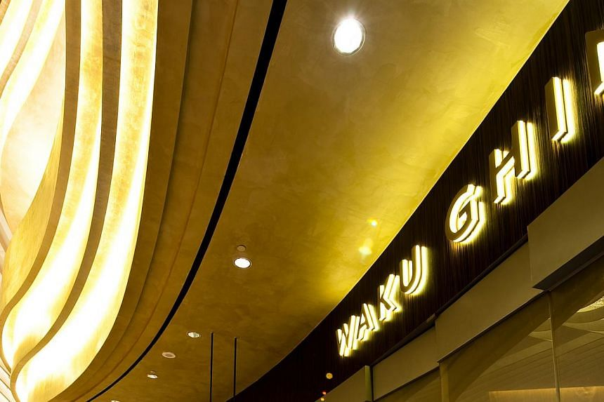 Waku Ghin restaurant at Marina Bay Sands serves just 25 people in a huge 10,000 sq ft space that, when the main doors of the restaurant are closed, effectively cuts diners off from the rest of the world for the duration of their meal. -- FILE PHOTO: