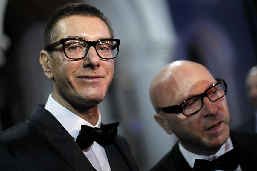 Italian designers Stefano Gabbana (left) stands next to Domenico Dolce as they talk to the media during a party marking the 25th anniversary of British model Naomi Campbell's career in downtown Shanghai in this October 28, 2010 file photo. Dolce and