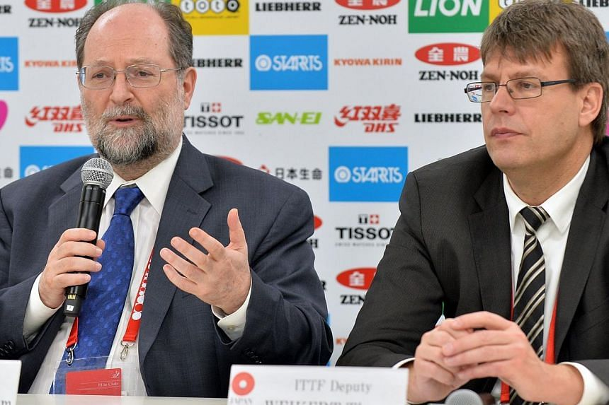 International Table Tennis Federation (ITTF) president Adham Sharara (left) and deputy president Thomas Weikert (right) attend a press conference at the 2014 World Table Tennis Championships in Tokyo on April 30, 2014. Long-term table tennis bos