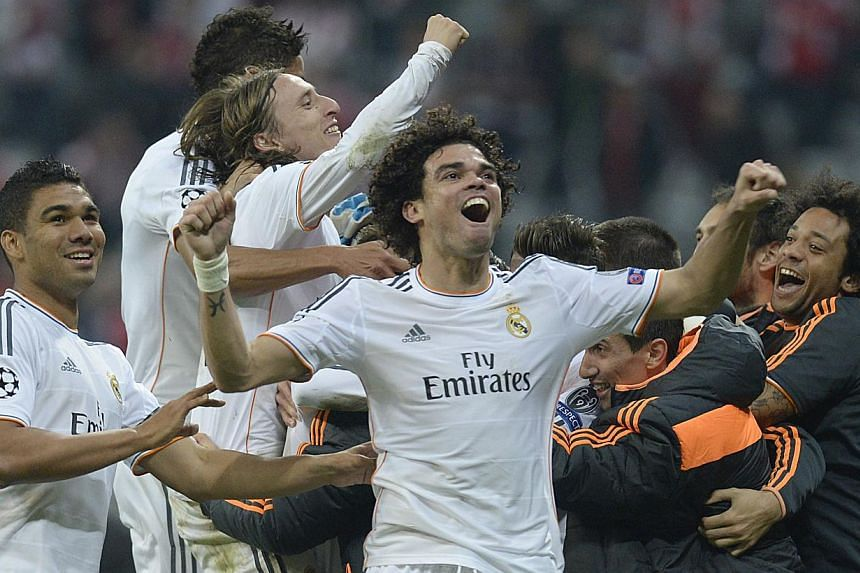 Real Madrid's players celebrate winning 0-4 in the Uefa Champions League second-leg semi-final football match against Bayern Munich in Munich on April 29, 2014. -- PHOTO: AFP
