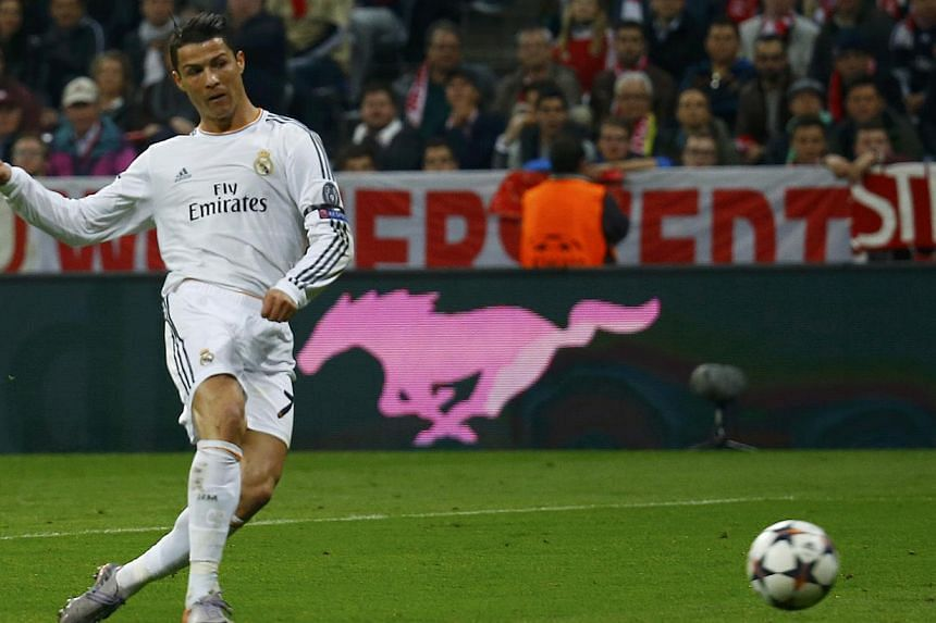 Real Madrid's Cristiano Ronaldo scores a goal against Bayern Munich during their Champion's League semi-final second leg soccer match in Munich on April 29, 2014. -- PHOTO: REUTERS